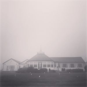 Practice session in front of Brighton & Hove clubhouse shrouded in fog