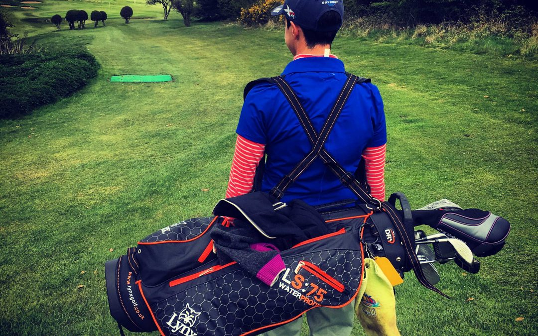 Am I damaging my back by carrying my golf bag?