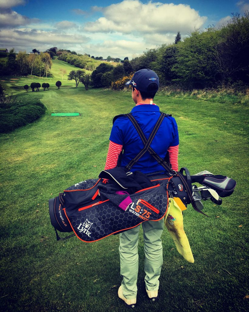 Is carrying my golf bag bad for my back?
